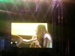 Haim on stage dancing to Happy